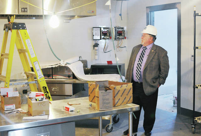 Shelby County Commissioner Bob Guillozet looks over what will be a new kitchen at Fair Haven Shelby County Home Thursday, Jan. 31.