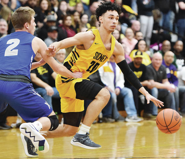 Luke Gronneberg | Sidney Daily News file photo Andre Gordon (right) and the Sidney boys basketball team are ranked 10th in the most recent Associated Press Division I state poll.