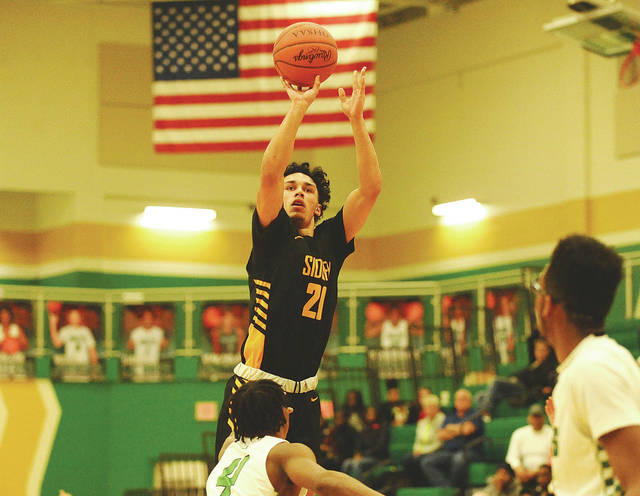 Greg Billing | For the Sidney Daily News Andre Gordon led Sidney with 22 points in the Yellow Jackets' 72-68 victory over Northmont on Tuesday.