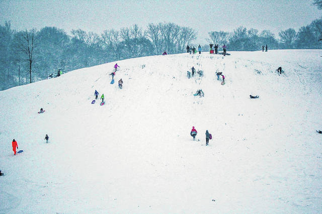 The Moose Lodge hill was filled with sledders Saturday, Jan. 12, as are residents enjoyed the first major snowfall of the winter.