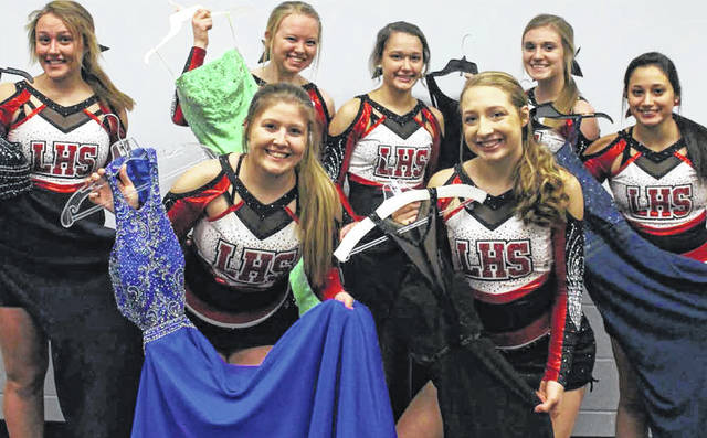 Fort Loramie junior cheerleaders display prom dresses that will be among those available during their dress exchange, Jan. 20. Pictured are, front row, from left, Desiree Fogerty, Jenna Fischkelta and Lili Rodriguez. Back row, from left, Hanna Siegel, Allie Barlagge, Abby Barhorst and Lora Grewe.