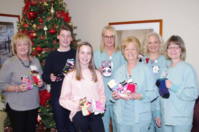 From left to right, JTD Hospital Foundation Executive Director Linda Haines; Woods Kemmler and Helli Kemmler; and JTDMH surgery department representatives Sheila Arnold, Chris Farr, Laureen Bruns, and Marge Doenges.