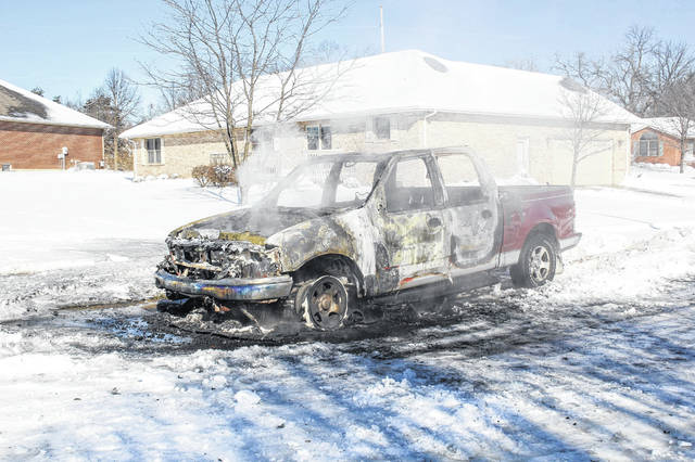Smoke billows from a pick-up truck that caught fire, Monday, Jan. 21, along Carly Lane in Sidney. The Sidney Fire Department responded to the fire at about noon. Firefighters theorized that someone tried to get the truck out of the snow by rocking it, and the engine overheated.