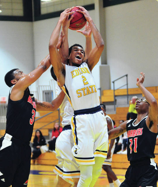 Mitchell Woods, 2, pulls down a rebound for the Chargers in January.