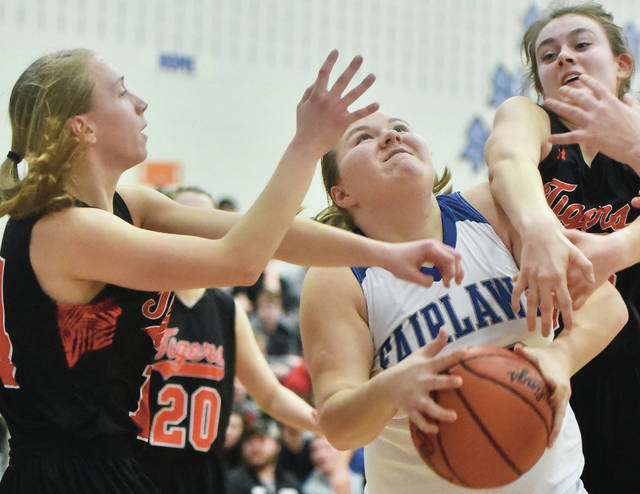 Fairlawn's Ashley Roush works to hold onto the ball as Jackson Center's Ashley Mullenhour and Elizabeth Hickey try to strip her of it during a Shelby County Athletic League game on Thursday at Fairlawn.