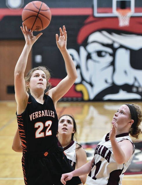 Versailles' Savannah Toner shoots over Urbana's Samantha Rooney and Marissa Horn during a Division III sectional quarterfinal on Thursday in Covington.