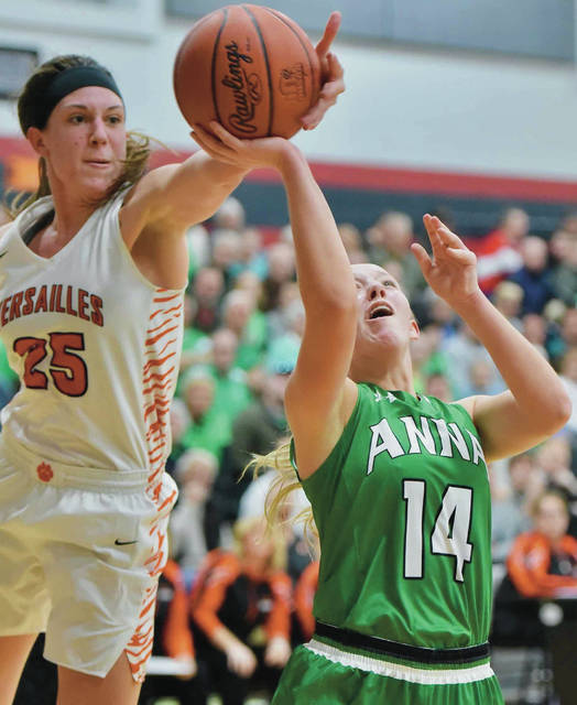 Anna's Breah Kuck shoots as Versailles' Lindsey Winner defends during a Division III sectional final on Monday in Covington.