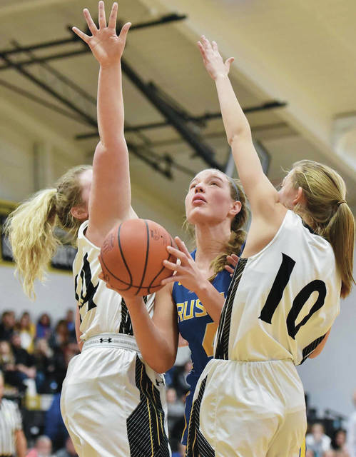 Russia's Laurissa Poling prepares to shoot against Botkins' Grace Homan and Makenna Maurer during a Division IV sectional semifinal on Saturday in Sidney.
