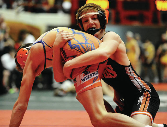 Versailles junior Cael Bey goes for a takedown during at 152-pound match at the Division III state dual team championships on Sunday at St. John Arena.