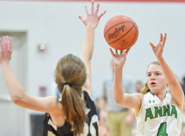 Anna's Amber Zimpfer shoots over Greenon's Reagan Ware during a Division III sectional semifinal on Thursday in Covington.