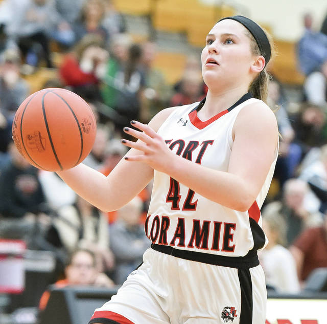 Fort Loramie junior forward Marissa Meiring goes for a layup during a nonconference game against Versailles on Dec. 22 in Fort Loramie. Meiring was voted the Shelby County Athletic League player of the year.