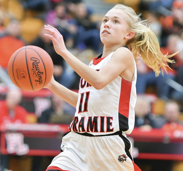 Fort Loramie sophomore guard Caitlyn Gasson goes for a layup after a steal during a nonconference game on Saturday in Fort Loramie.  Bryant Billing | Sidney Daily News