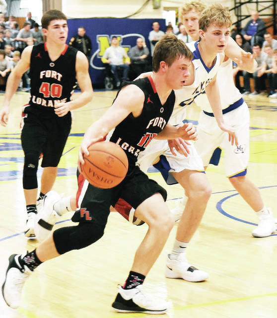 Fort Loramie's Nick Brandewie dribbles during a nonconference game on Saturday in Maria Stein.