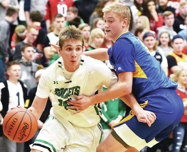 Anna's Griffin Doseck drives past Marion Local's Nathan Bruns during a nonconference game on Jan. 5 in Anna. The Rockets are ranked No. 6 in Division III in this week's state Associated Press poll.