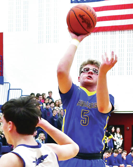Lehman Catholic s Bryce Kennedy shoots during a Division IV sectional  opener on Saturday at Piqua s Garbry Gymnasium. 6c4a6067b