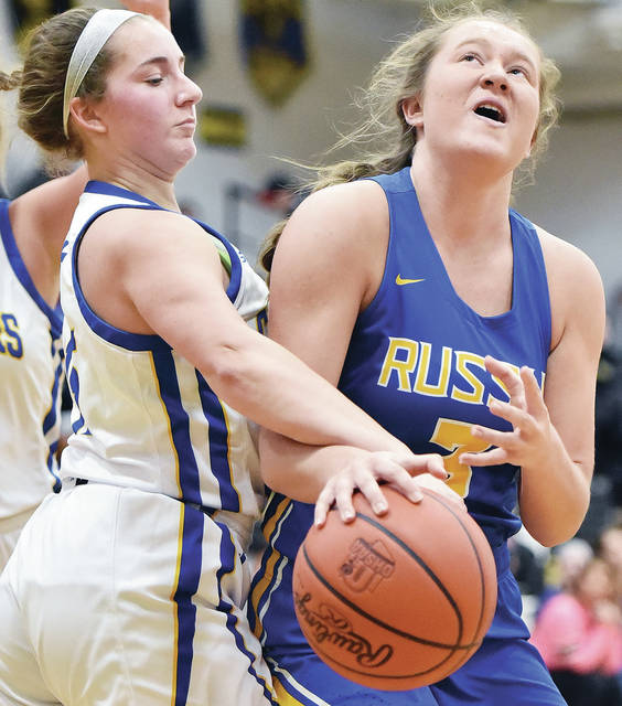 Russia senior guard Jenna Cordonnier drives as Lehman Catholic's Hope Anthony defends during a Division IV sectional quarterfinal on Wednesday in Sidney.