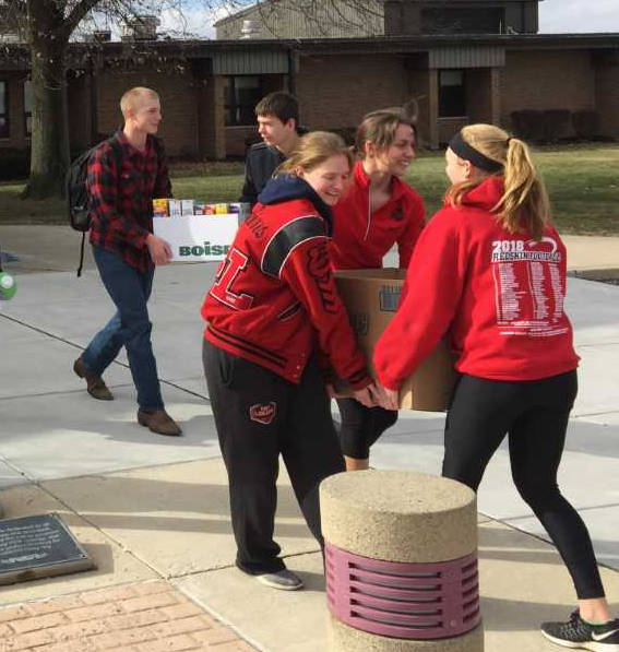(left to right) Fort Loramie High School students Justin Puthoff, back left, Jason Chaney, back right, Cassidy Albers, front left, Chloe Stang, center, and Ellie Holthaus, front right.