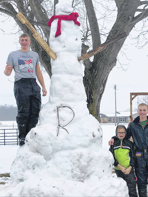 Receiving honorable mention for the snowman contest were senior Michael, freshman Samuel, and third-grader Sophia York, children of Mike and Maria York.