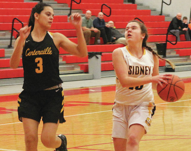 Sidney's Marta Rodriguez, right, dribbles with pressure from Centerville's Amy Velasco during a Division I sectional semifinal on Wednesday at Troy's Trojan Activities Center.