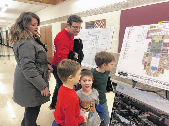Lisa and Joe McGovern, and their sons Connor age 6, Liam age 4, and Aidan age 8, look at the designs for the new New Bremen Elementary School. Joe McGovern said the kids were excited about going to the new school.