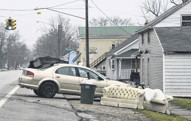 A junk car waits to be towed after an accident nearly two weeks ago. The stationary vehicle was among the issues discussed at the Port Jefferson Village Council meeting, and which will be addressed by the Port Jefferson Police Department as part of the village clean-up currently underway.