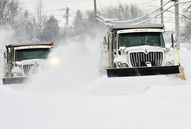 City of Sidney employees plow Wapakoneta Avenue, Friday, Feb. 1.