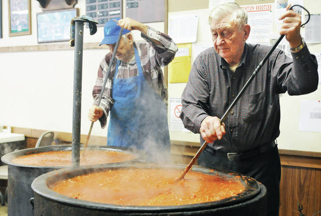 Paul Short, left, of Newport, and Conrad Phlipot, of Russia, stir spaghetti sauce for the Newport Sportsmen Club's Hospice Dinner. The Hospice Dinner will be held Sunday, Feb. 10, starting at 11 a.m.