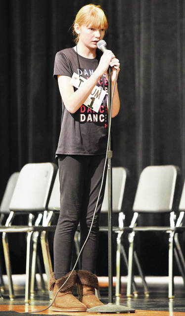 "Tatum Werntz spells ""chivalrous"" correctly to earn the title of 2019 Spelling Bee champion of Sidney City Schools City Wide Spelling Bee Tuesday, Feb. 5. The bee was held at Sidney Middle School auditorium. Tatum is the daughter of TJ Werntz and Tina Woodell. She attends sixth-grade at Sidney Middle School."