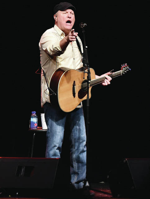 Collin Raye performs during a Gateway Arts Council presentation at the Sidney High School Sunday, Feb. 10. Numerous organizations and people donated to bring Raye to Sidney.