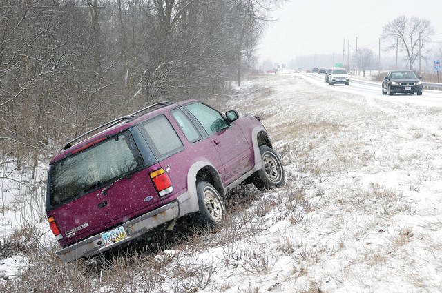 A vehicle sits in a ditch on County Road 25A just north of Interstate 75 around 2:30 p.m. Sunday, Feb. 10. There were a number of crashes and slide-offs as snow fell Sunday.