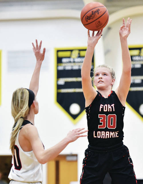 Fort Loramie's Dana Rose shoots as Mississinawa Valley's Olivia Murphy defends during a Division IV sectional quarterfinal on Tuesday at Sidney High School. The Redskins led 58-8 by halftime on their way to a 72-point win.