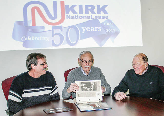 Looking over old newspaper clippings about Kirk NationaLease are left to right, current owner Jeff Phlipot, of Fort Lormanie, co-owner until 1985 Fred Kirk, of Sidney, and co-owner from 1985 to 2008 Lloyd Schroer, of New Breman. Jim Harvey, co-owner with Schroer from 1985-96, could not make it. Philip N. Kirk, who co-owned the business with his brother, Fred, is deceased. The past and present owners got together, Monday, Feb. 18, at the business to begin celebrations of Kirk NationaLease's 50th anniversary. Celebrations will continue throughout the year. The firm was founded by Norton Kirk.