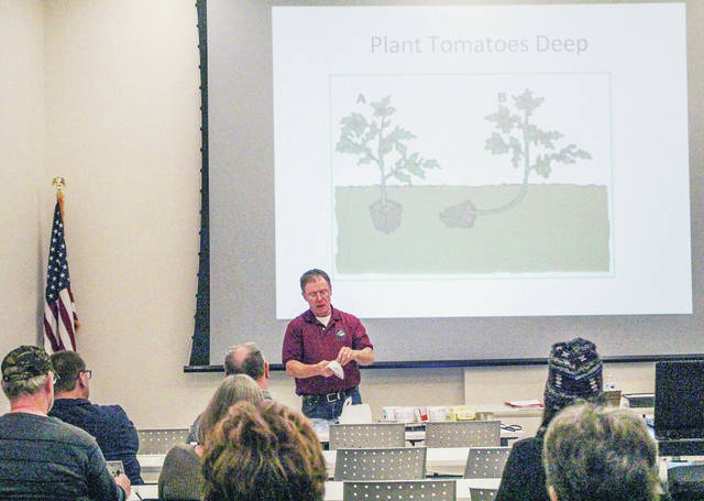 Master Gardener Jim McCracken, of Anna, gives a talk on planting tomatoes at the Amos Memorial Public Library Wednesday, Feb. 20.