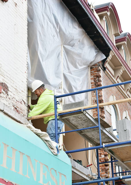 Meyer Restoration employee Mike Snow, of Houston, works on replacing the upper front wall of KB's Tap House at 111 S. Ohio Ave. Wednesday, Feb. 27. The brick wall had been sagging due to a rotting wood support beam. The brick work should be finished in roughly three weeks.