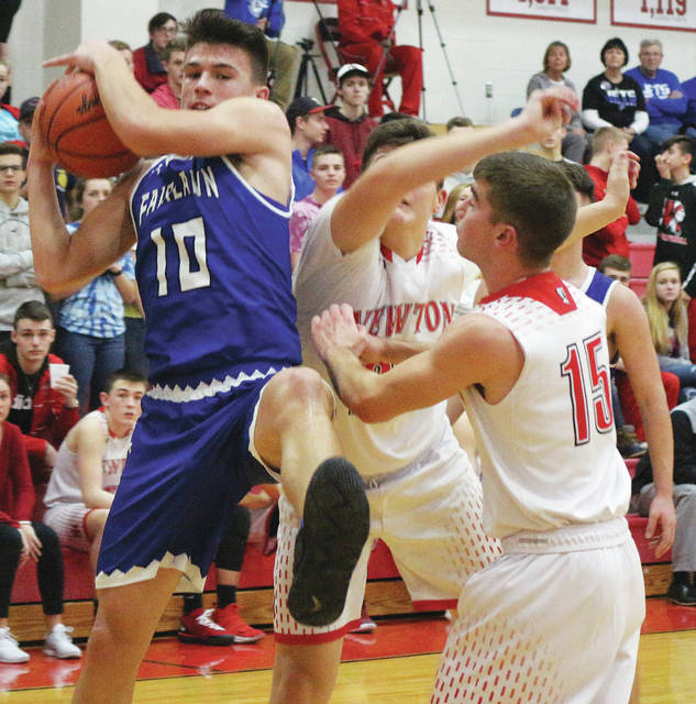 Fairlawn sophomore Skyler Piper comes down with a rebound with pressure from Newton defenders during a nonconference game on Wednesday in Pleasant Hill. Piper led all scorers with 21 points.