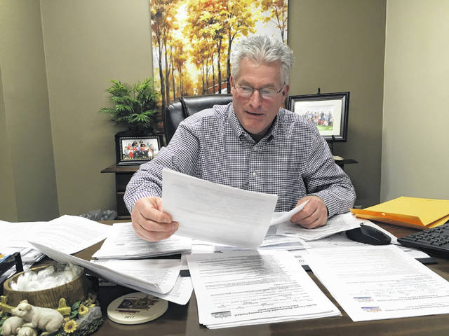 Shelby County Commissioner and Shelby County Bicentennial Beer Subcommittee Chair Tony Bornhorst looks over some of the many entry forms received for those hoping to win the grand prize in the Shelby County Bicentennial Beer Naming Contest.