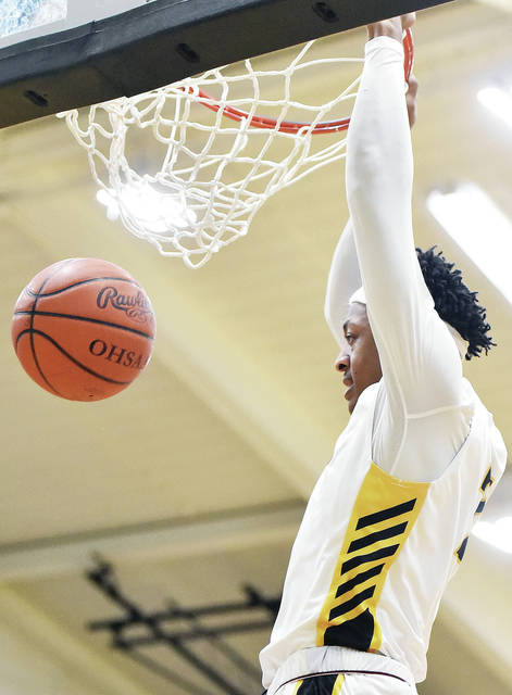 Sidney's Ratez Roberts dunks during a nonconference game on Monday against Lehman Catholic in Sidney.