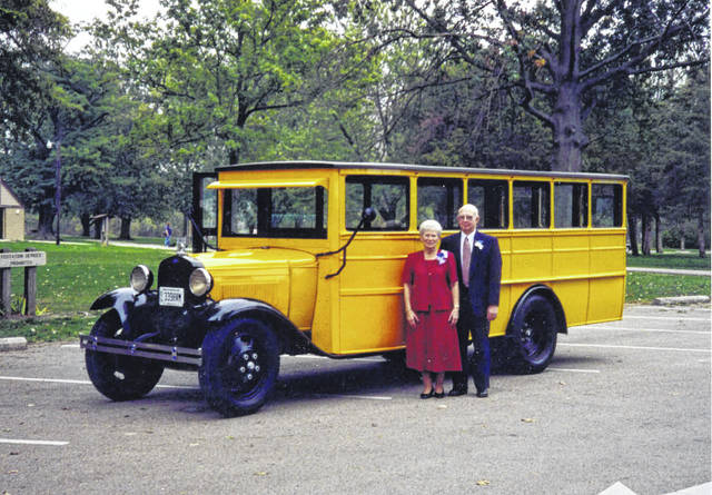 After: Carol and Wil Prenger pose with the 1934 Wayne-bodied school bus they restored.