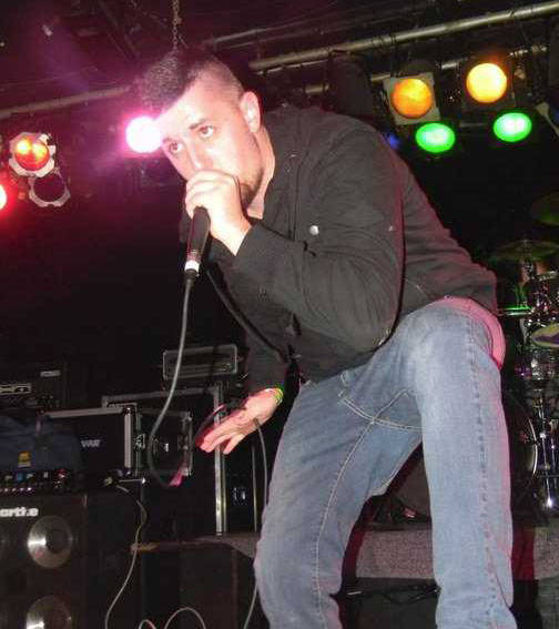 Joshwa Moon, Minster native and lead singer of the heavy hard core rock band Hostile performs with his band during a recent show.