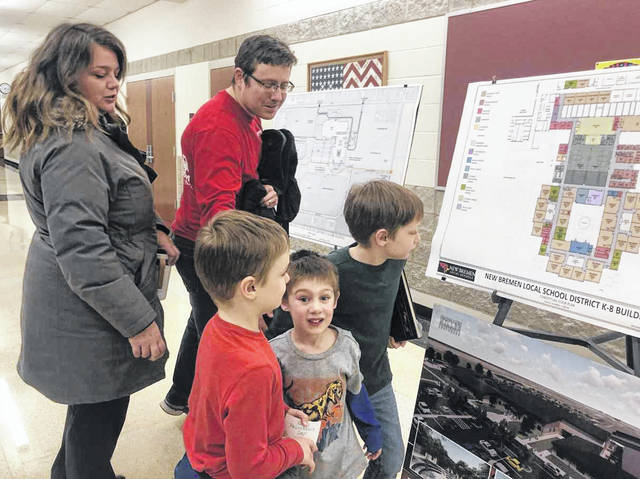 Lisa McGovern, left, along with husband Joe McGovern, view blueprints for the new K-8 building in New Bremen, along with sons Connor, front left, age 6; Liam, center, age 4; and Aidan, age 8. Joe said the kids were excited about going to the new school.