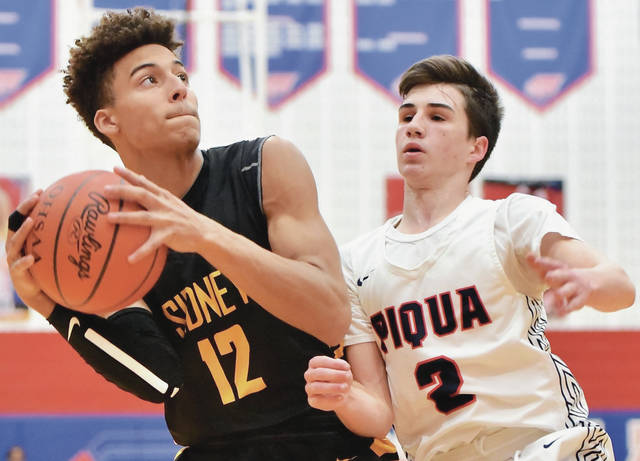 Sidney's Lathan Jones looks to get past Piqua's Kameron Darner during a Greater Western Ohio Conference American North Division game on Friday in Piqua.