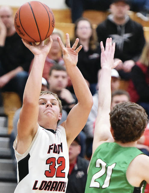 Fort Loramie's Nate Meyer shoots as Bethel's Tompson Bean defends at during a nonconference game on Tuesday in Fort Loramie.