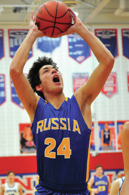 Russia's Daniel Kearns scores two of his 16 first-half points in a Division IV sectional semifinal against Fairlawn on Thursday at Piqua's Garbry Gymnasium.