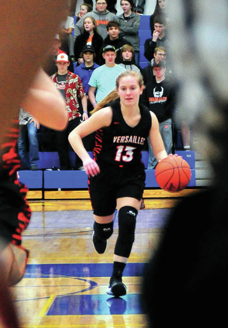 Versailles' Caitlin McEldowney brings the ball down the floor during a Division III regional semifinal on Wednesday at Springfield High School.