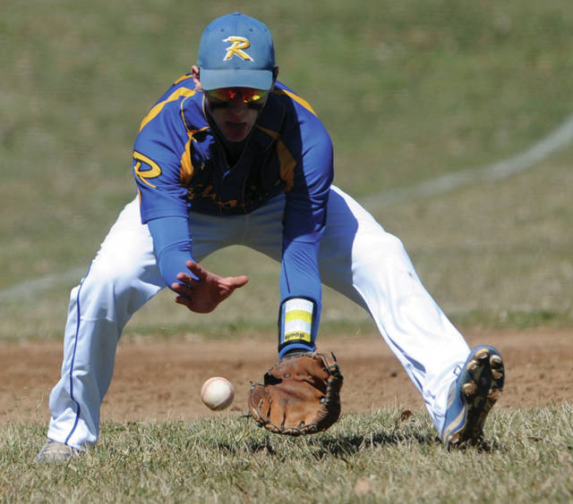Russia third-baseman Aiden Shappie fields a ground ball during a season-opening nonconference game on Saturday in Piqua.