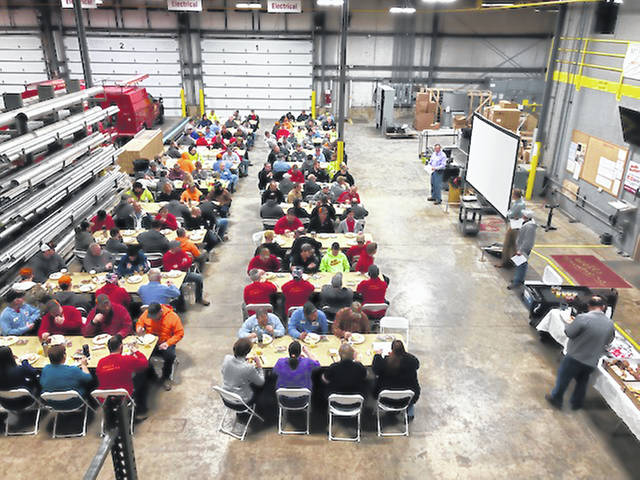 Employees of Wells Brothers and Panel Control Inc. enjoy breakfast in the plant in celebration of the company's 30th anniversary, March 18.