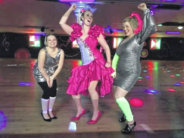 Paula Hill, left, of Sidney, Jessica Elliott, of Port Jefferson, and Tracey Landrum, of Sidney, practice some moves in their 1980s duds as they prepare for SCARF's 1980s Prom and Dance Party scheduled for March 9.