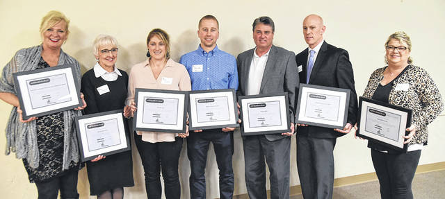 Sidney-Shelby County Chamber of Commerce Beautification Awards were presented to, left to right, Sandi Shipman, Berkshire Hathaway Home Services Professional Realty; Evelyn Flock, Eleven Fifty Seven; Misty Reese, Vin & Joy; Chad Otte, Sidney Family Eye Care; Tim Gleason, Realty 2000; David O'Leary, Sidney-Shelby County YMCA; Amanda Partington, New Choices Inc. Other recipients included Orthopedic Associates of SW Ohio, Low Voltage Solutions and Love's Travel Stop.
