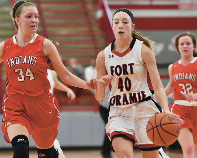 Fort Loramie's Colleen Brandewie drives while covered by Cedarville's Ruby Stack during a Division IV district final on Saturday in Troy.