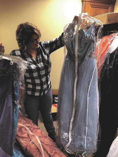 Kelly Cook, a member of the Fletcher UMC, sorts through dresses for the first-ever Hope Closet free prom dress ministry. The ministry will open to teens looking for a free dress beginning at 10 a.m. though 2 p.m. next Saturday at the church.